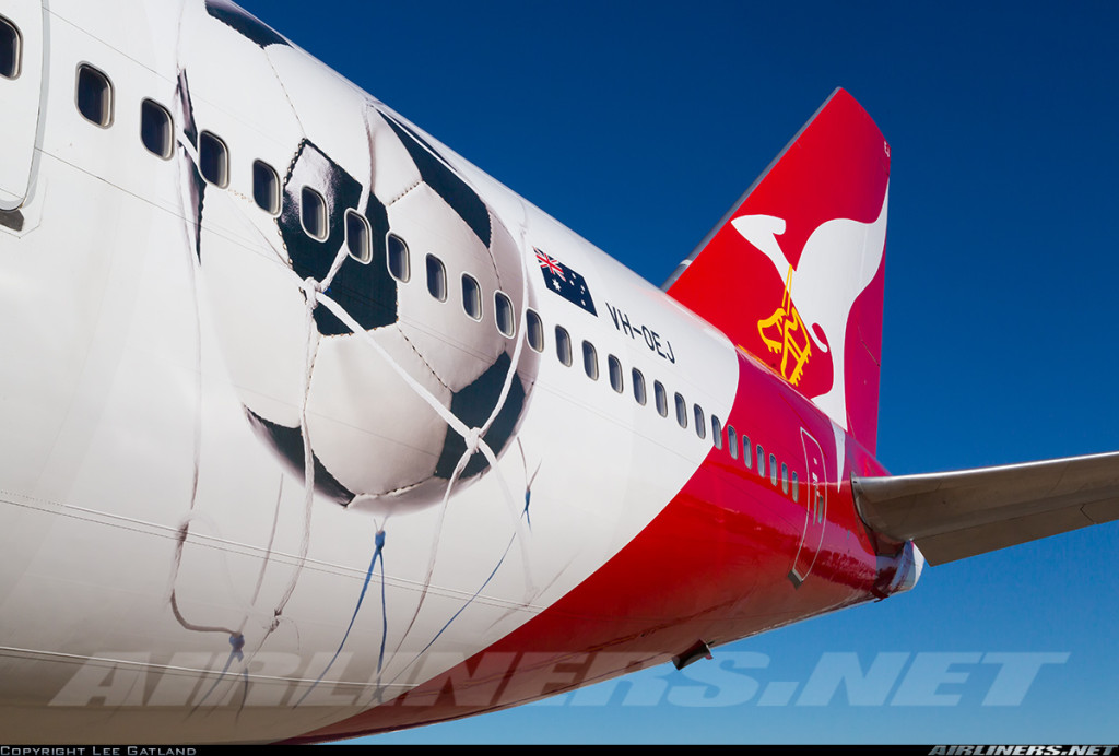 Qantas have painted Boeing 747-400 with a large football and goal, and football boots applied to the kangaroo logo on the tail. Photo (c) Lee Gatland