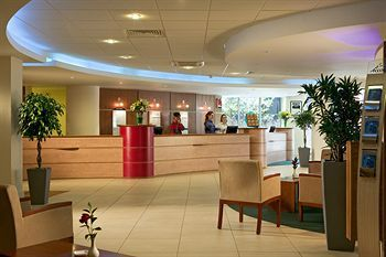 The sleekly contemporary front desk at the ibis London Heathrow Airport belies the hotel's cut-rate accommodations.