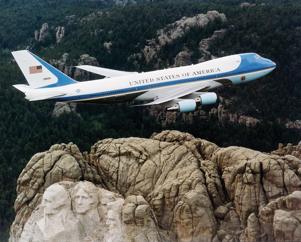 """Air Force One over Mt. Rushmore"" by U.S. Air Force File Photo. - http://web.archive.org/web/20070315005902/http://www.af.mil/news/airman/0104/trans21b.html, http://www.af.mil/shared/media/photodb/photos/021126-O-9999G-024.jpg. Licensed under Public Domain via Wikimedia Commons - http://commons.wikimedia.org/wiki/File:Air_Force_One_over_Mt._Rushmore.jpg#mediaviewer/File:Air_Force_One_over_Mt._Rushmore.jpg"
