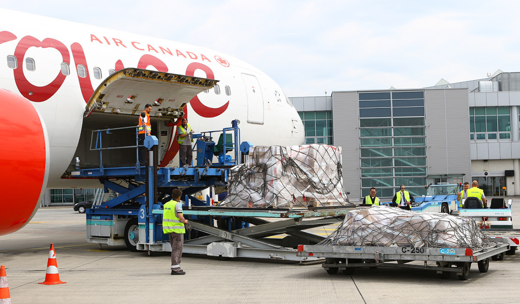 Air Canada Rouge 767-300 C-FMWQ unloading freight